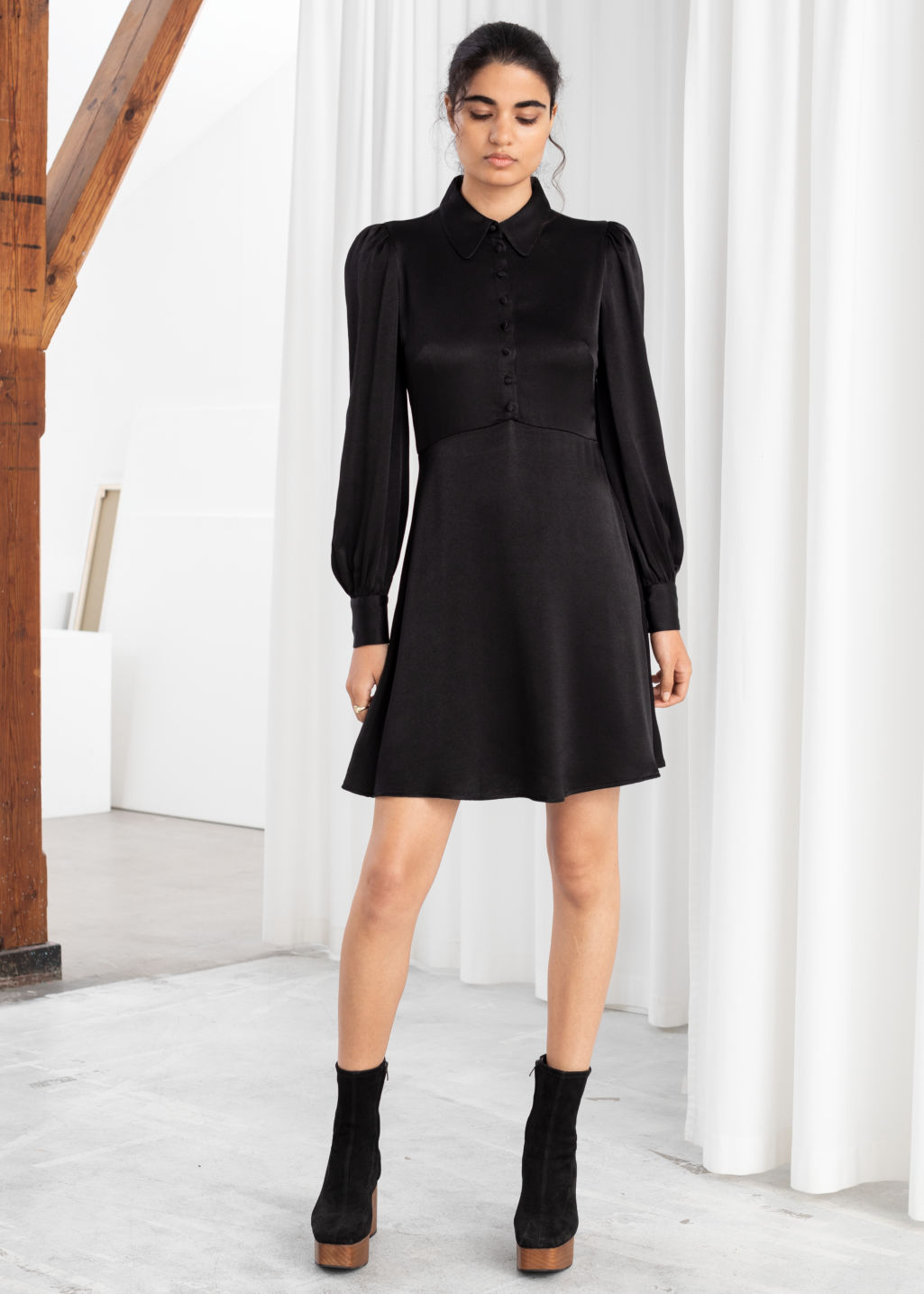 Model front image of Stories satin mini shirt dress in black