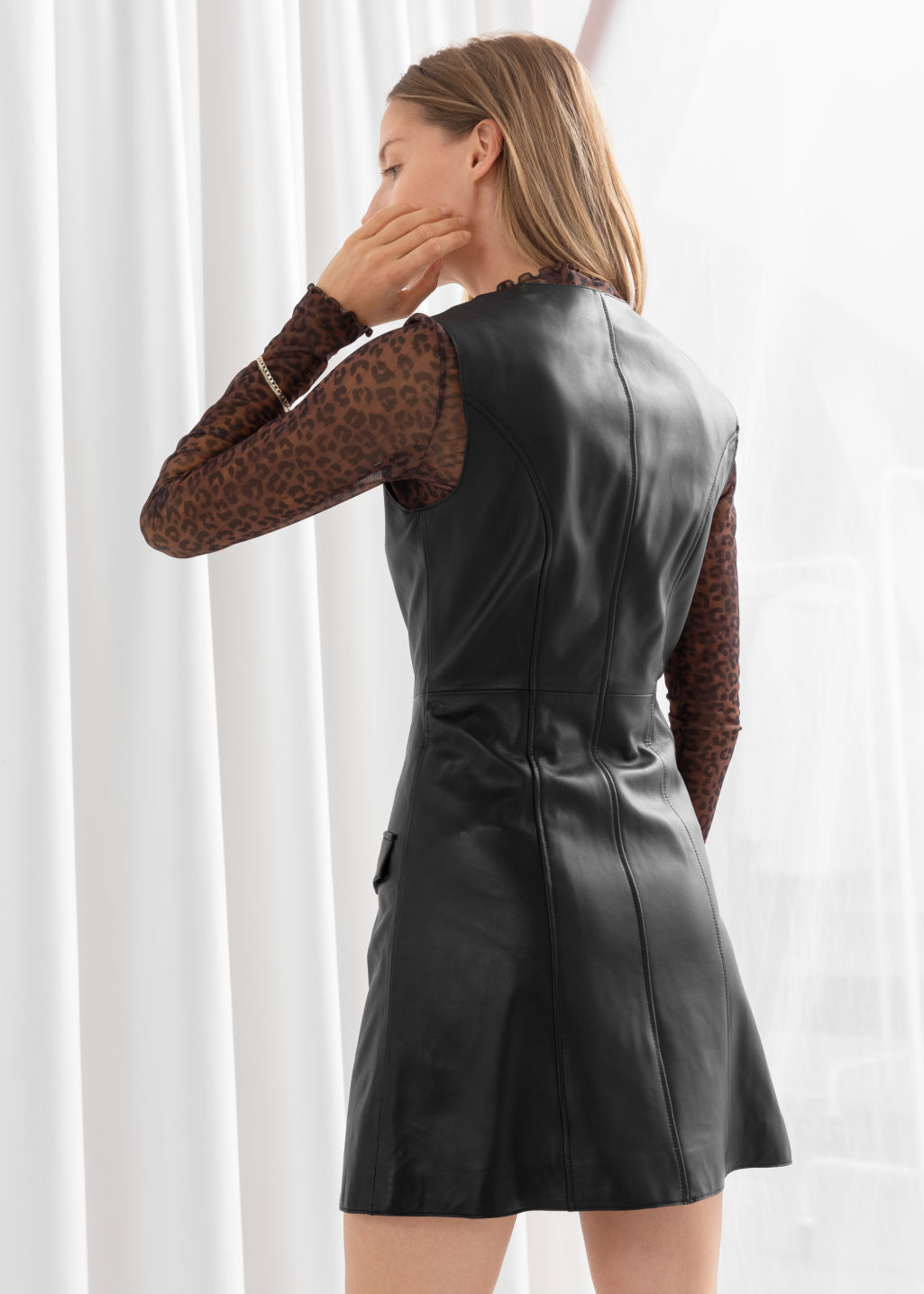 Model back image of Stories leather sleeveless mini dress in black