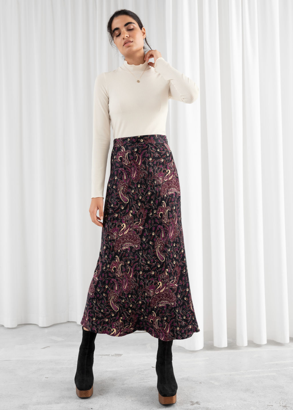Model front image of Stories flowy satin midi skirt in black