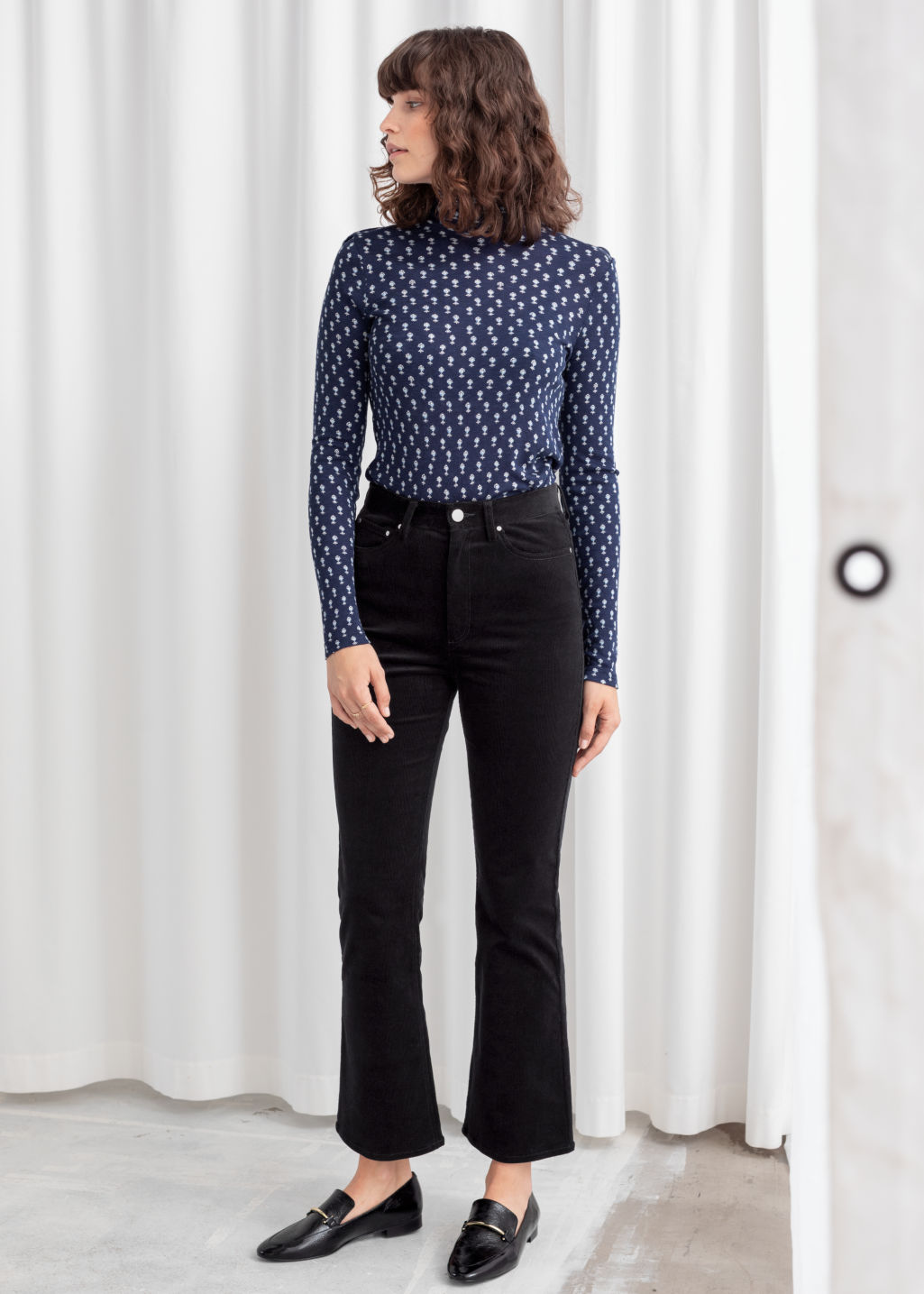 Model front image of Stories corduroy kick flare trousers in black