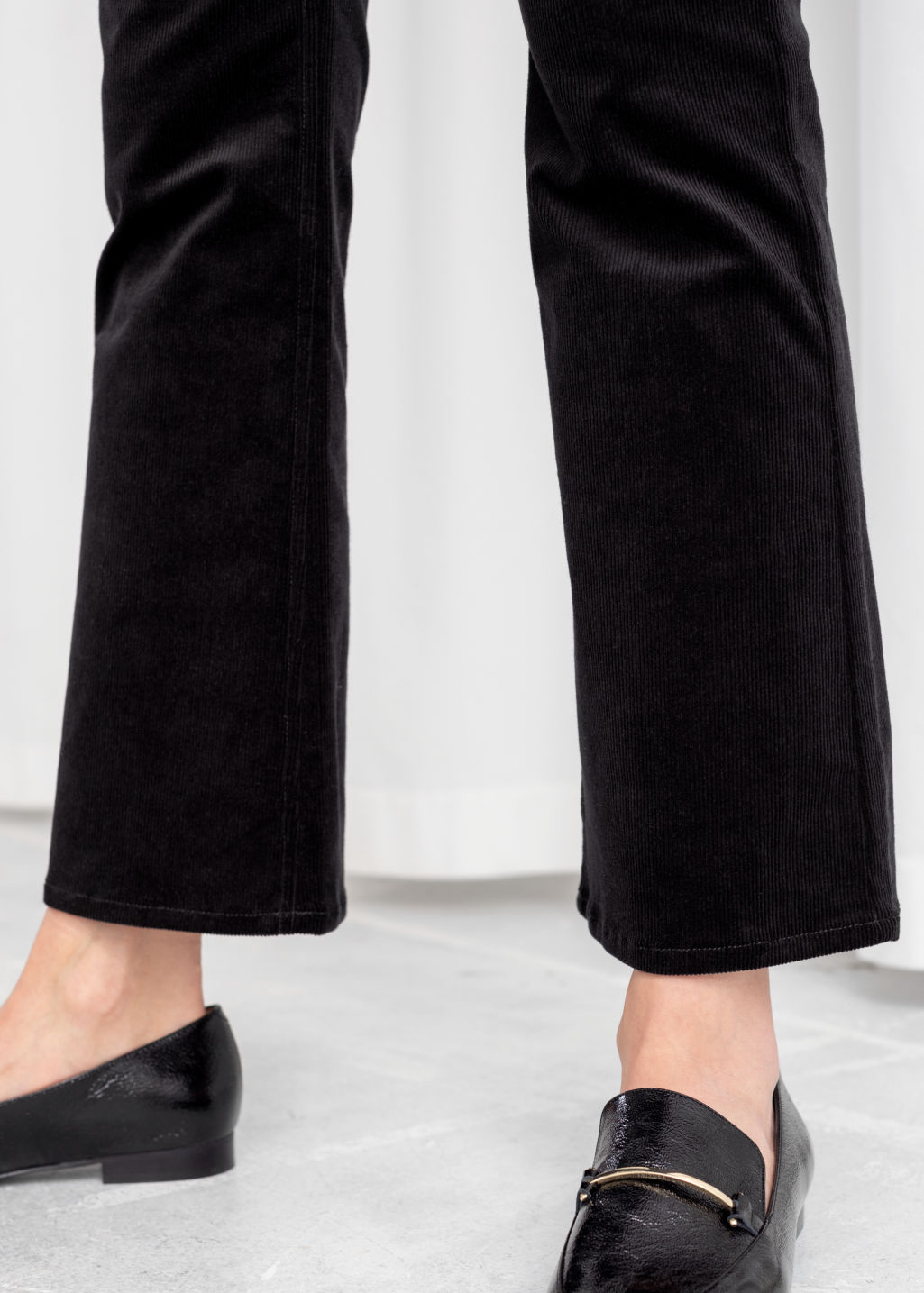 Model back image of Stories corduroy kick flare trousers in black