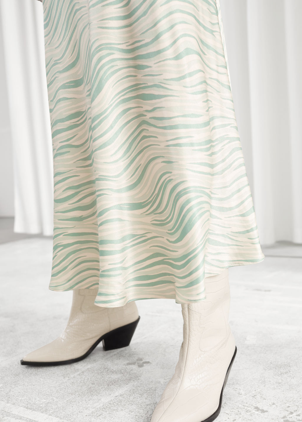 Model front image of Stories bias cut satin midi skirt in green