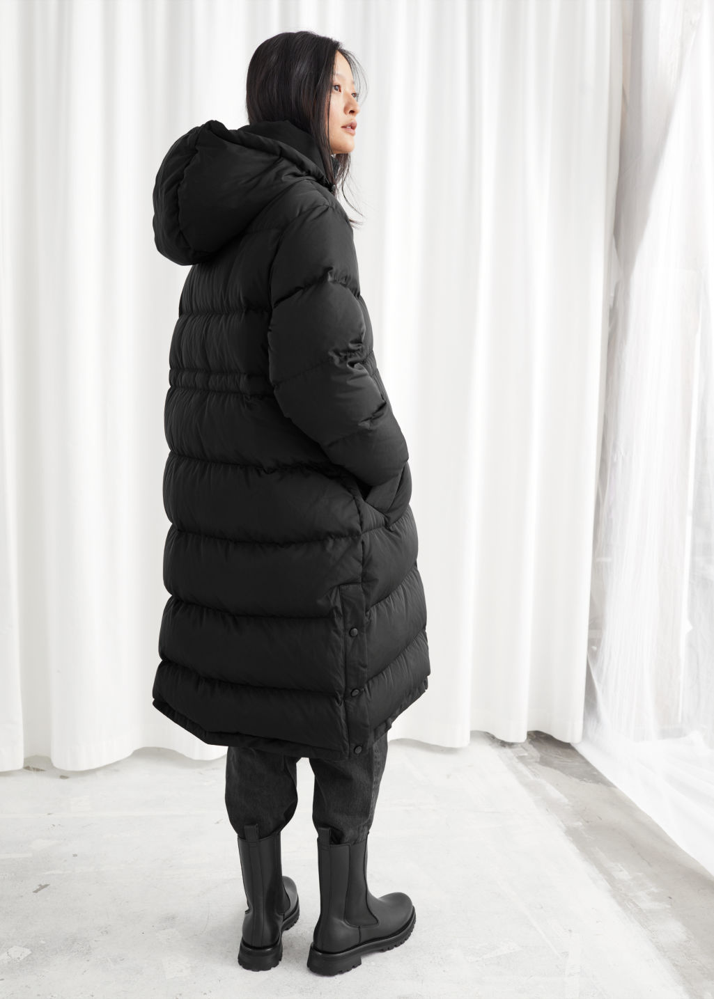 Model back image of Stories hooded down puffer coat in black