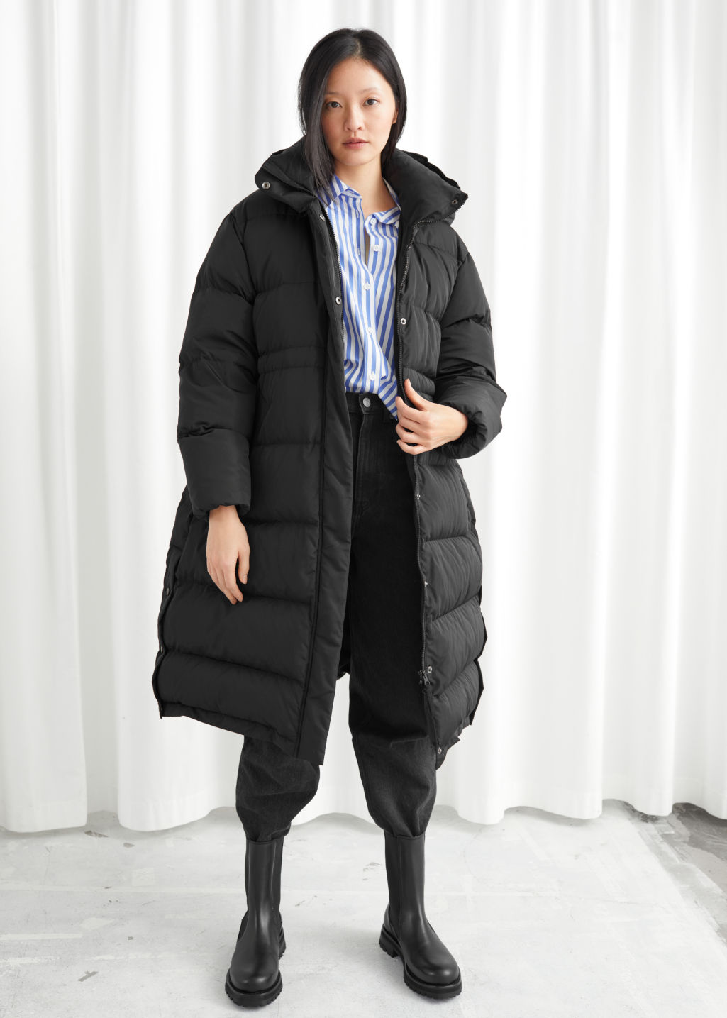 Model front image of Stories hooded down puffer coat in black