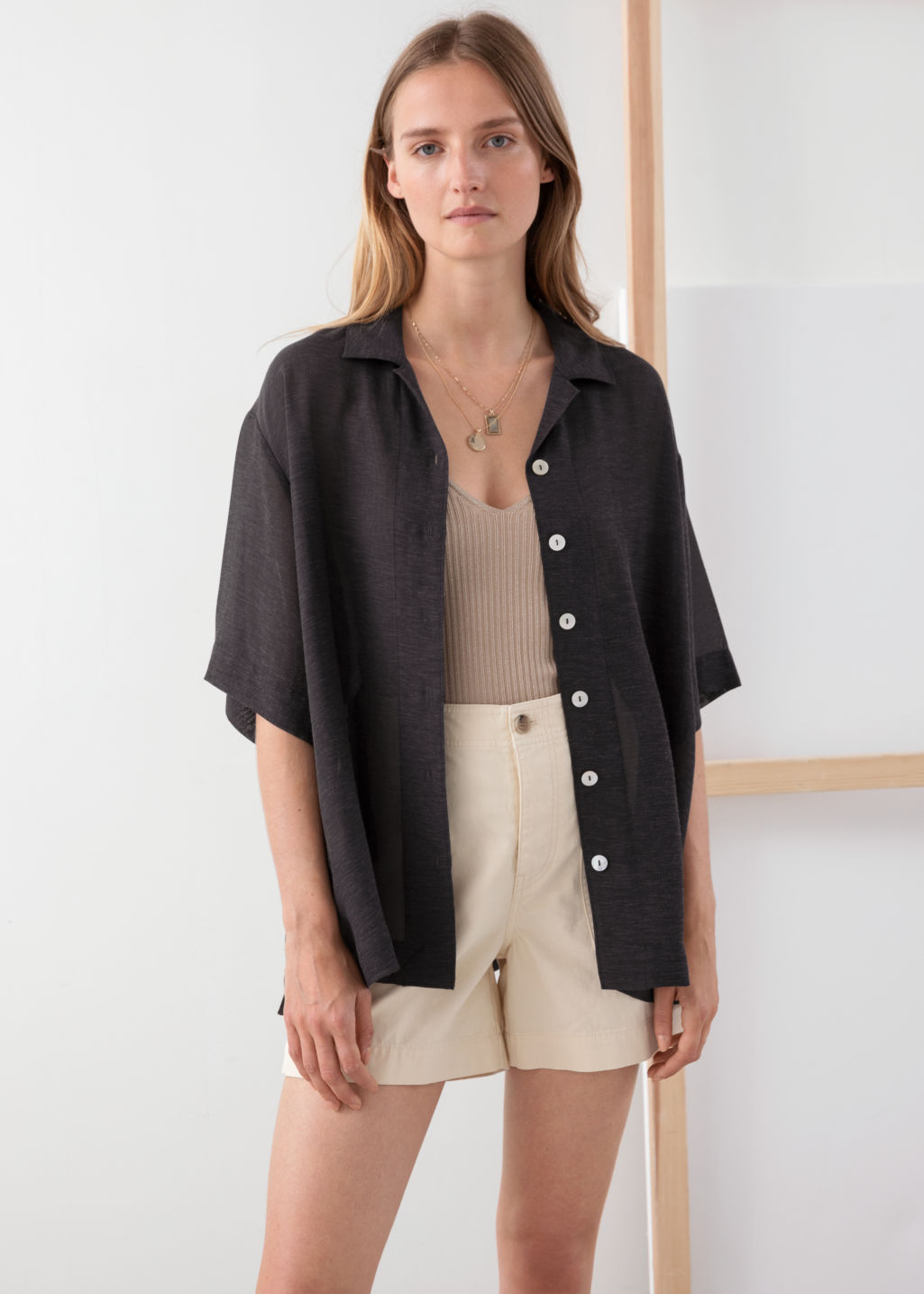 Model front image of Stories lyocell blend button up shirt in black