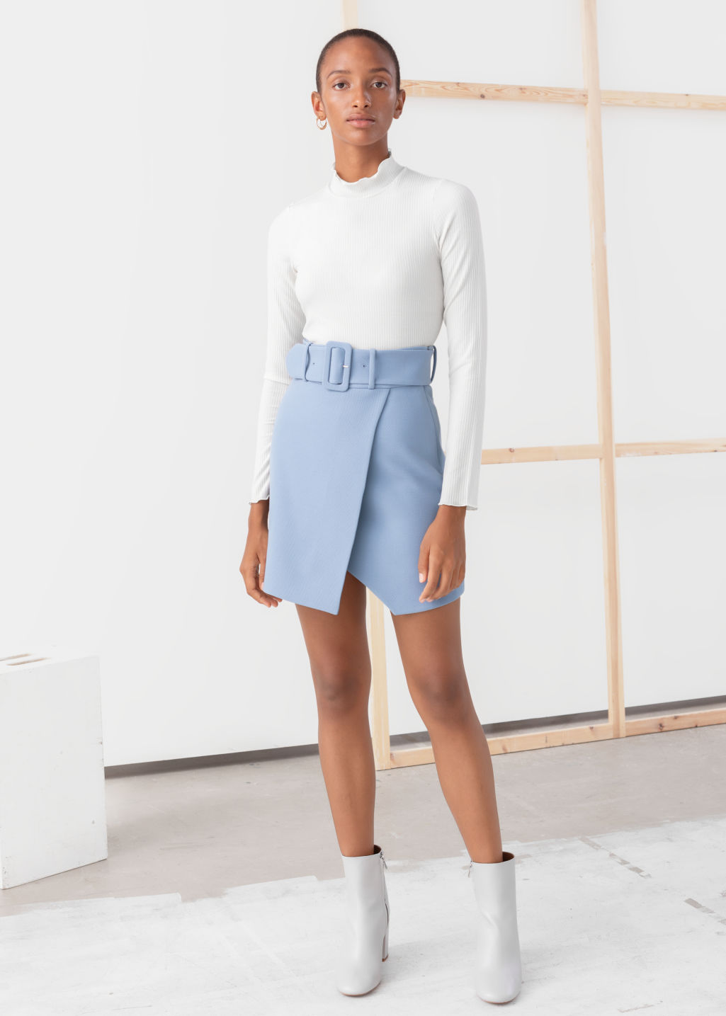 Model front image of Stories belted overlap mini skirt in blue