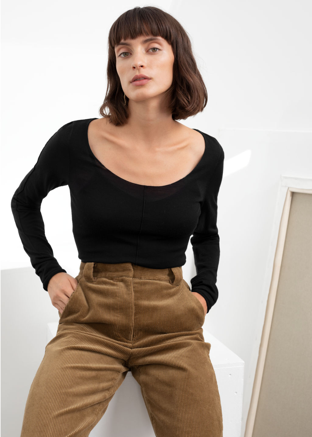 Model front image of Stories scoop neck fitted wool top in black