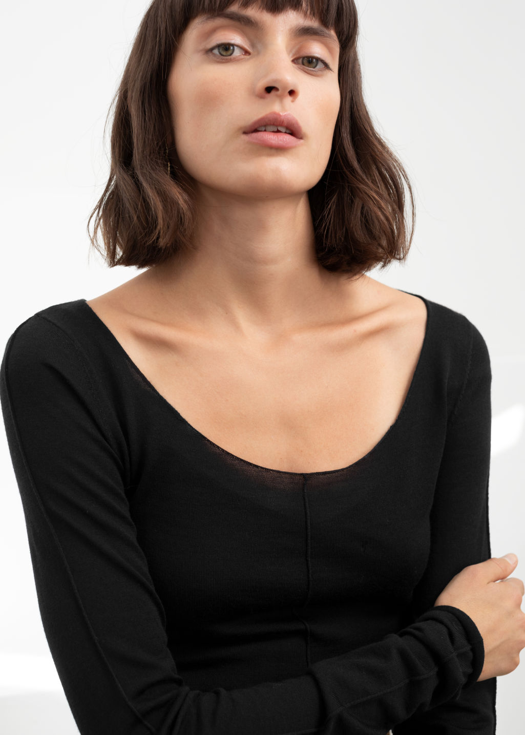 Model back image of Stories scoop neck fitted wool top in black
