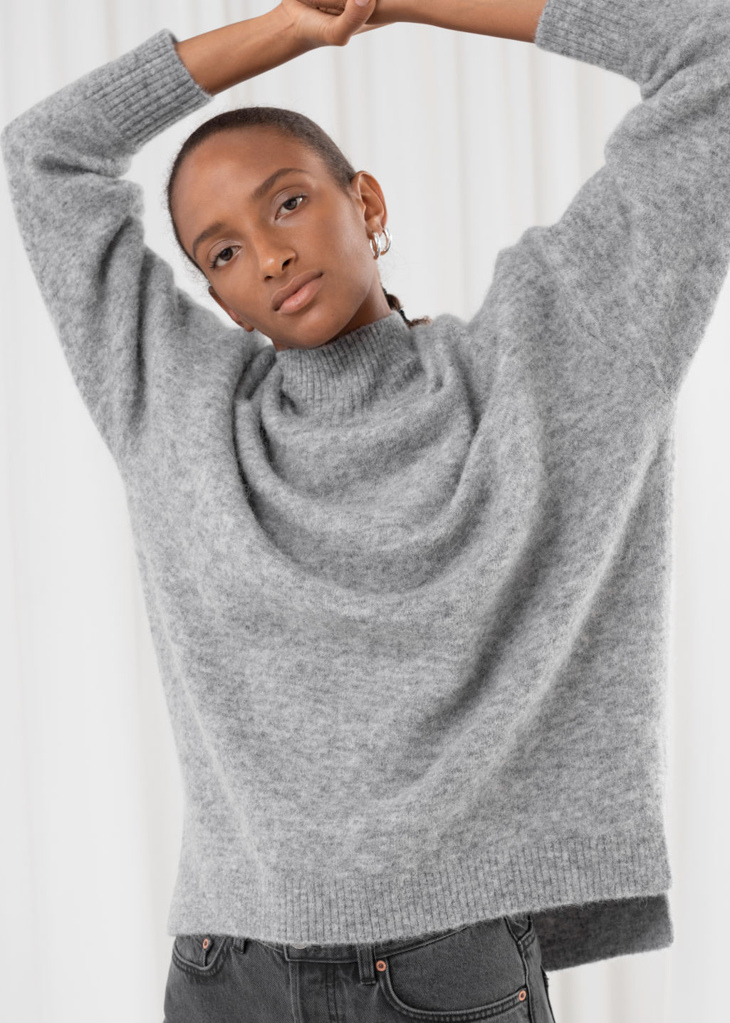 Model front image of Stories oversized mock neck sweater in grey