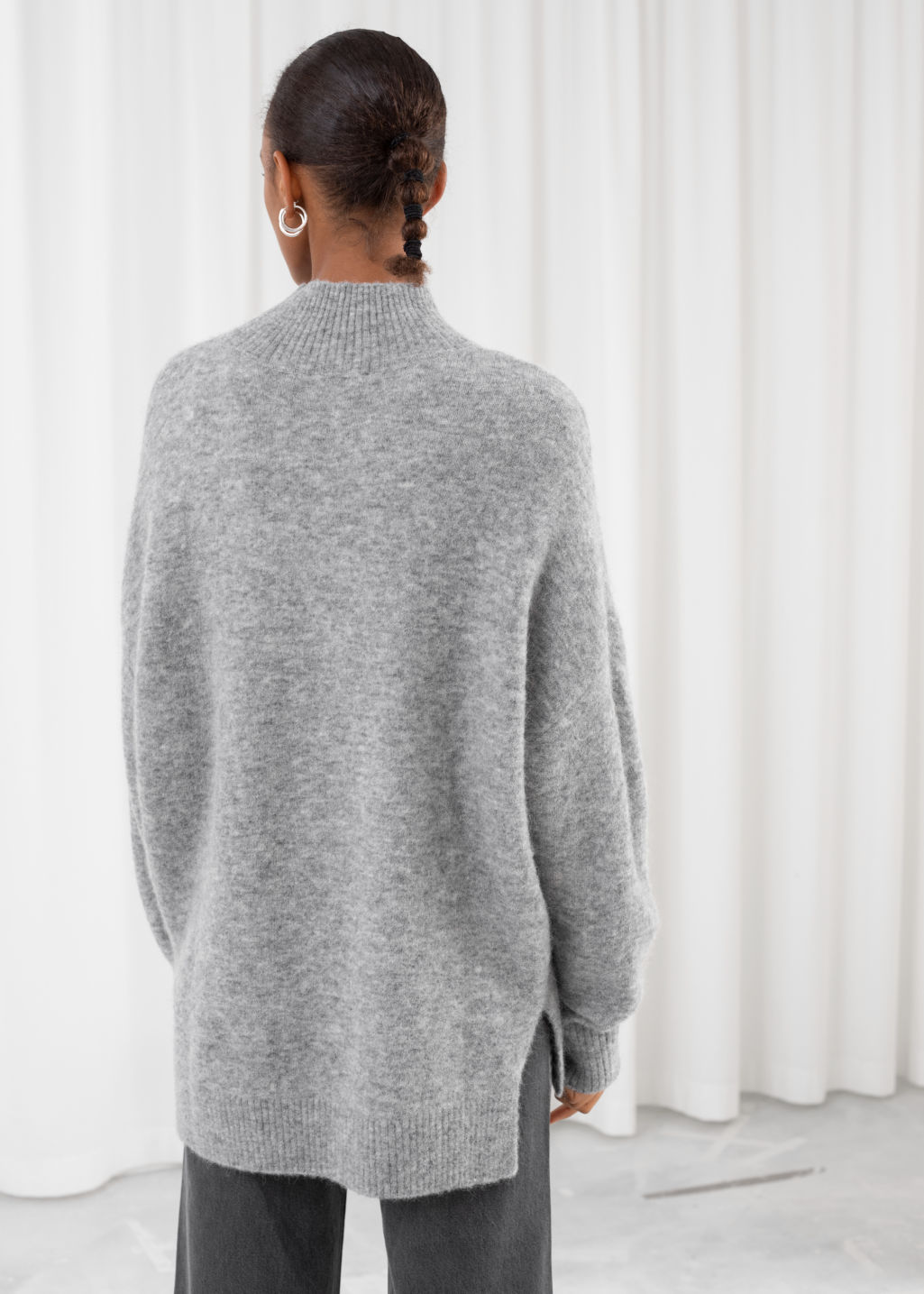 Model back image of Stories oversized mock neck sweater in grey