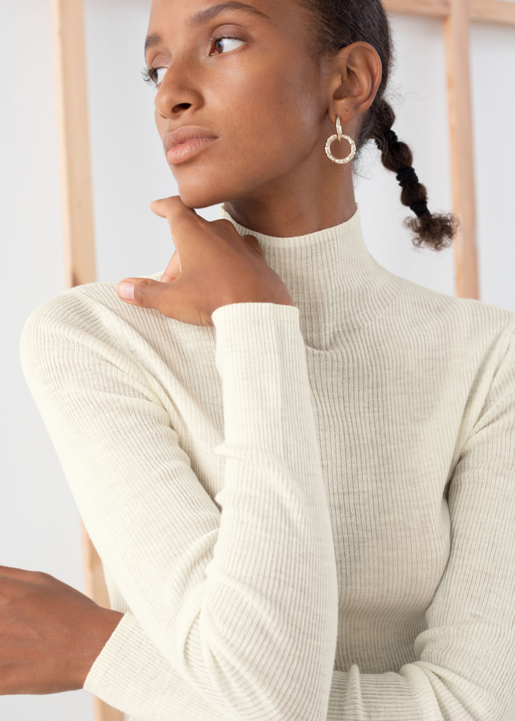 Model back image of Stories ribbed knit wool turtleneck in white