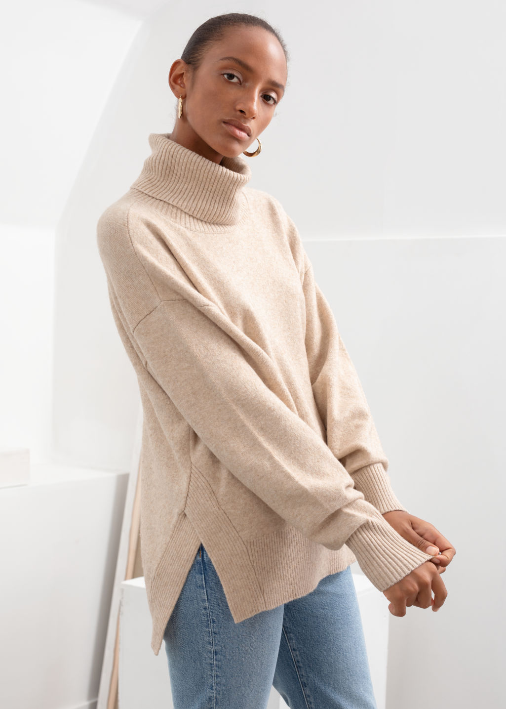 Model front image of Stories boxy turtleneck sweater in beige
