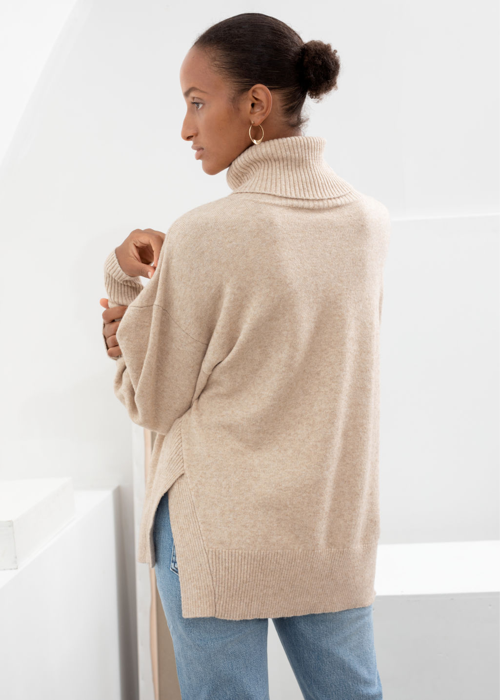 Model back image of Stories boxy turtleneck sweater in beige