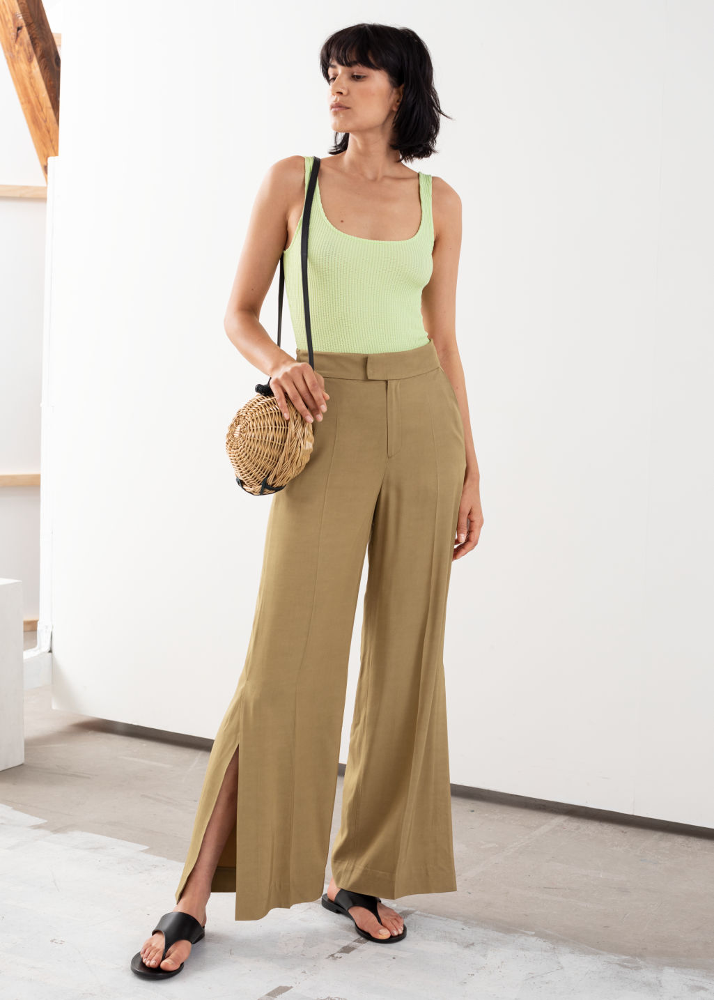 Model front image of Stories high waisted side slit flared trousers in beige