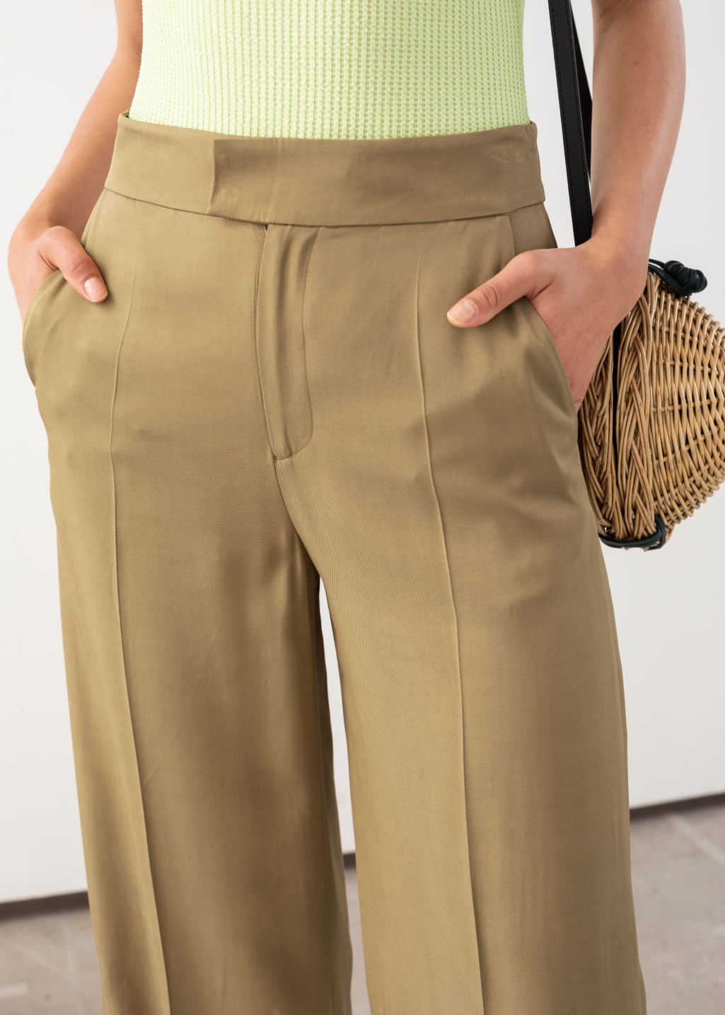 Model back image of Stories high waisted side slit flared trousers in beige