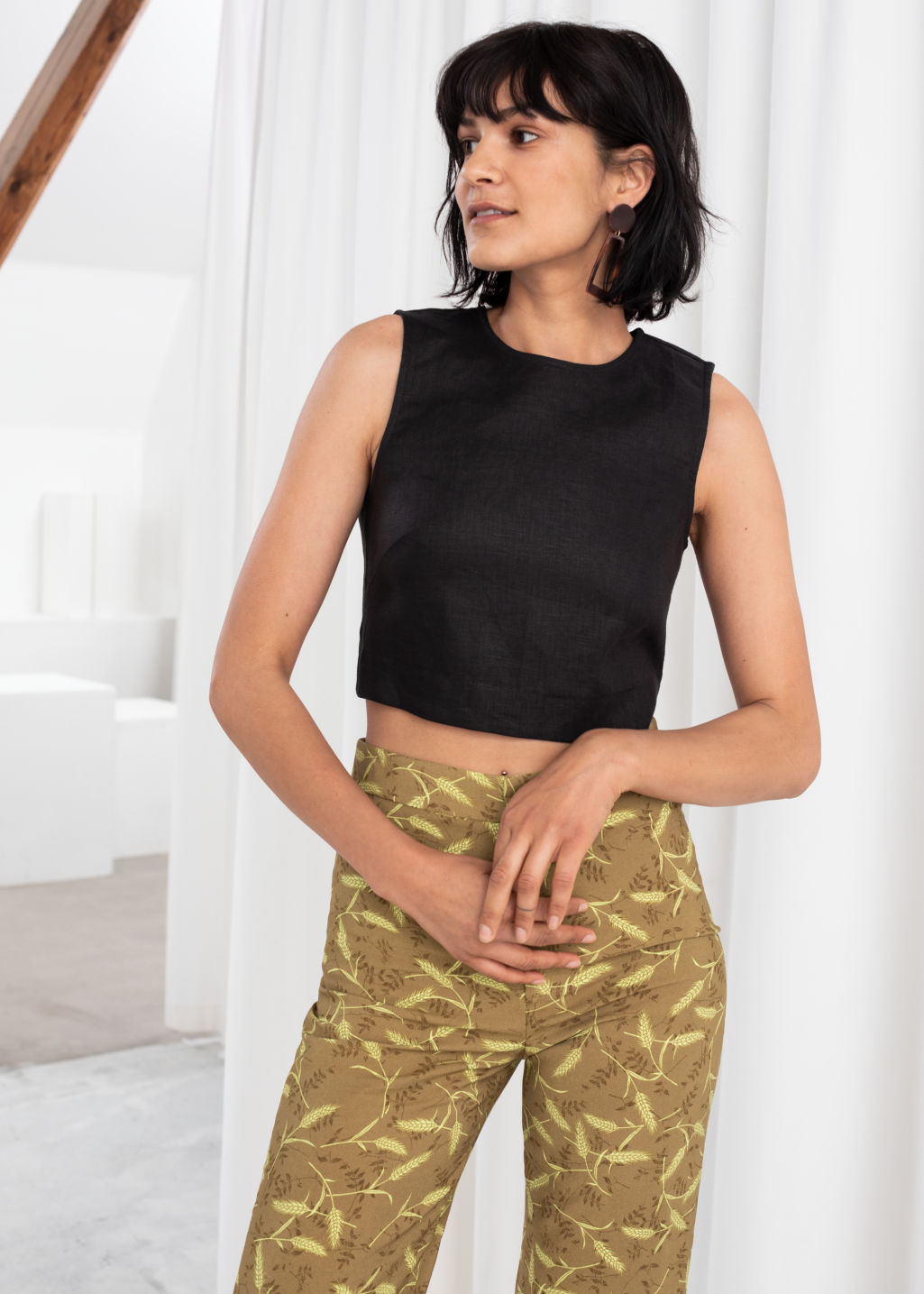 Model front image of Stories cropped lyocell tank top in black