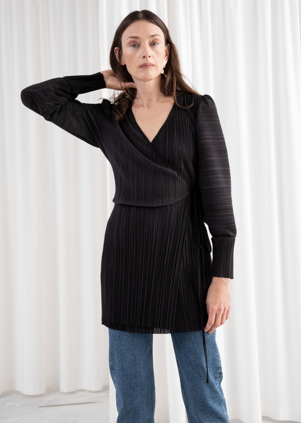 Model front image of Stories plissé pleated mini wrap dress in black