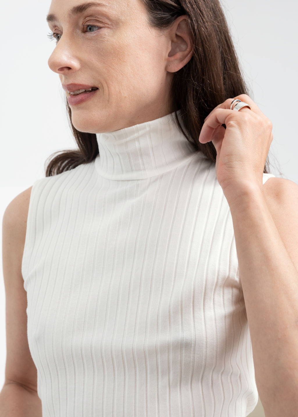 Model back image of Stories ribbed turtleneck tank top in white