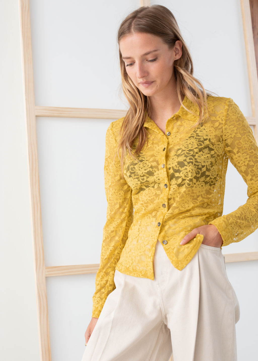 Model front image of Stories sheer floral lace blouse in yellow