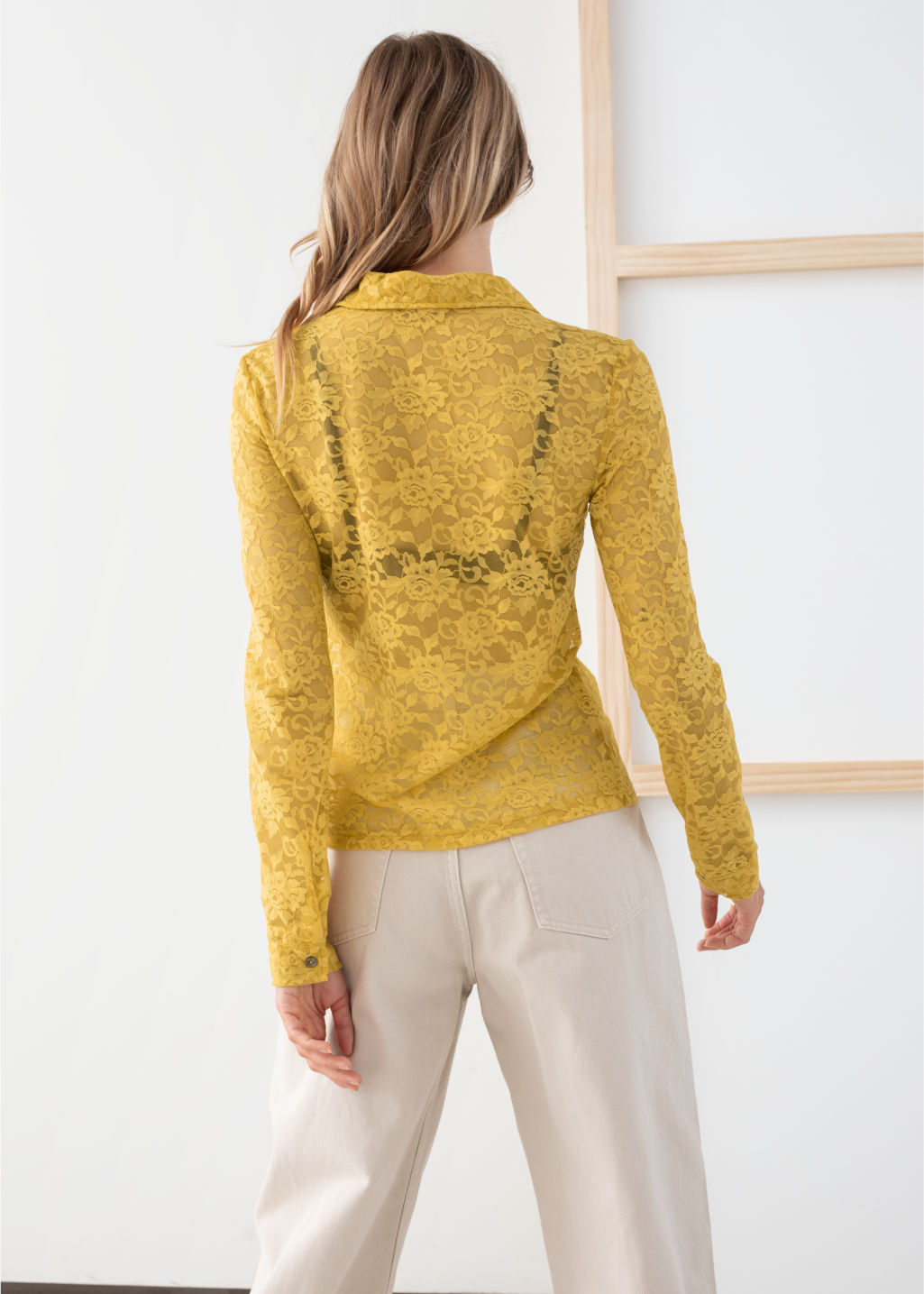 Model back image of Stories sheer floral lace blouse in yellow