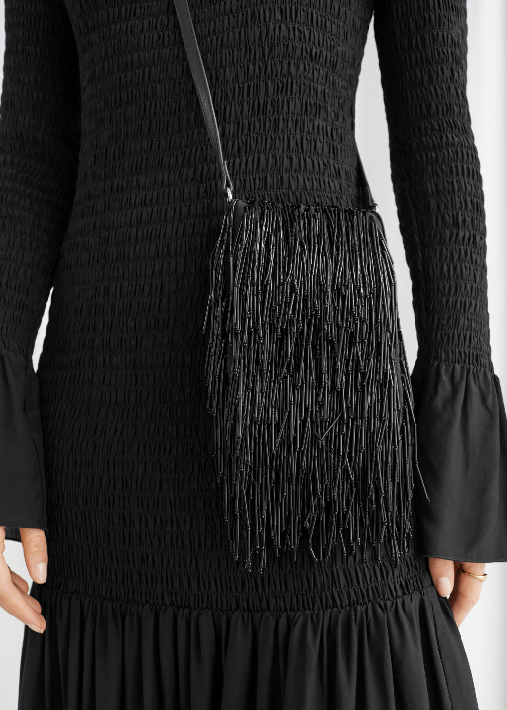 Model front image of Stories fringed beaded crossbody bag in black