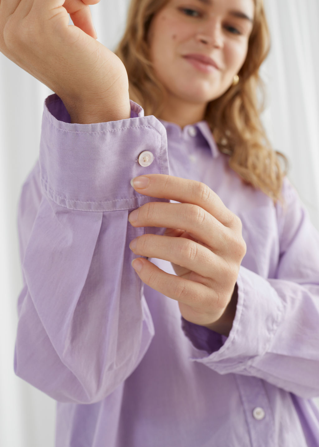Model front image of Stories oversized organic cotton button up shirt in purple