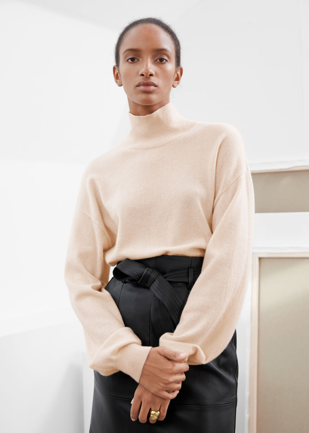 Model front image of Stories cashmere puff sleeve turtleneck in orange