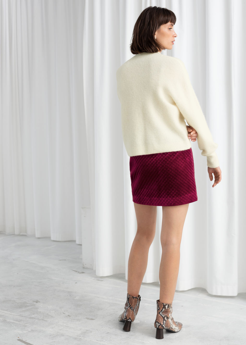 Model back image of Stories quilted velour mini skirt in pink
