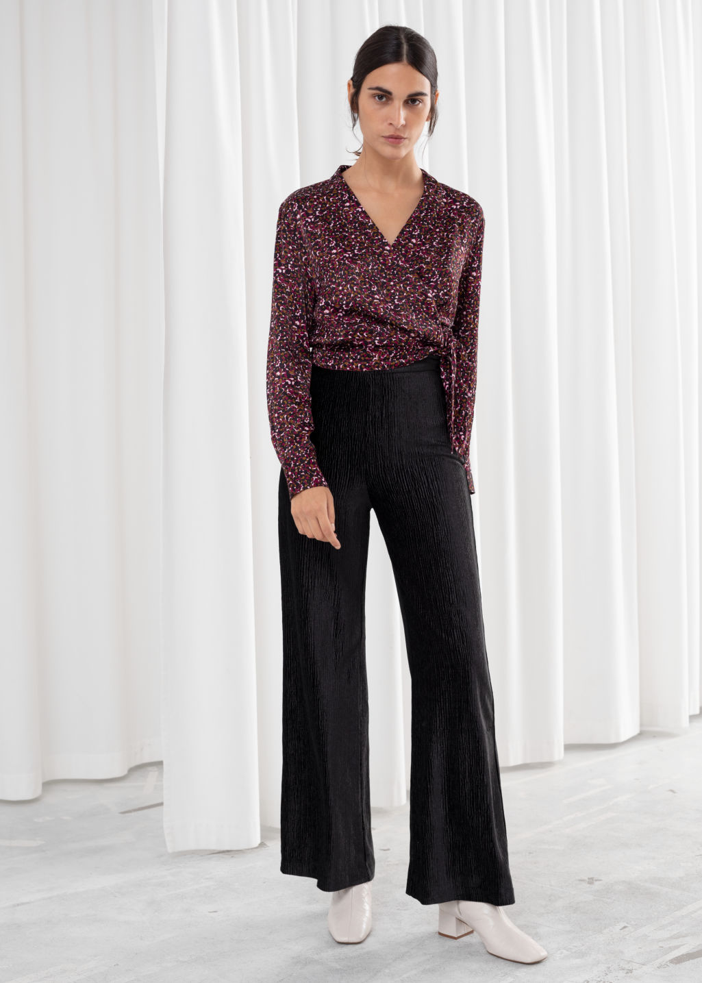 Model front image of Stories flowy velour ribbed trousers in black