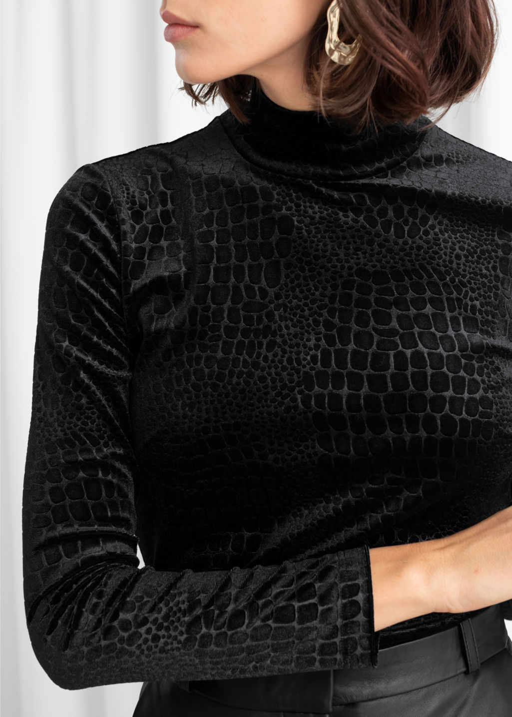Model back image of Stories croco print velour turtleneck top in black