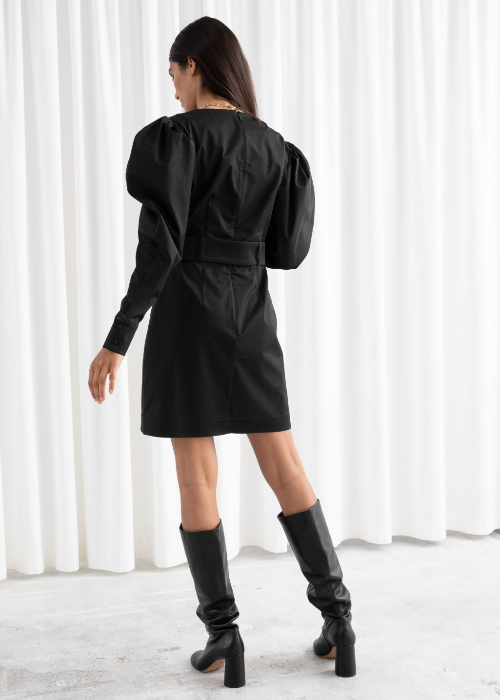 Model back image of Stories belted puff sleeve mini dress in black