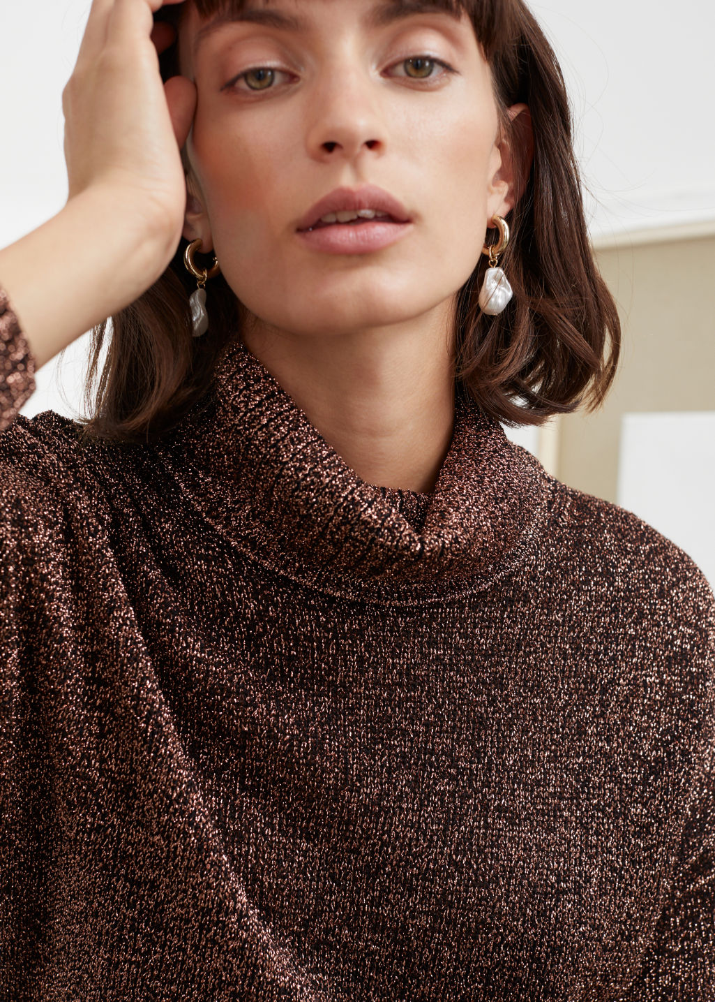Model front image of Stories relaxed glitter turtleneck in beige