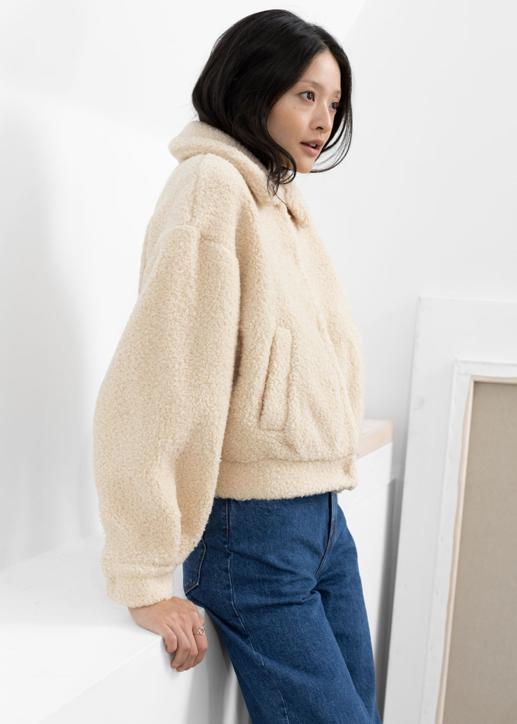 Model front image of Stories faux shearling teddy jacket in beige