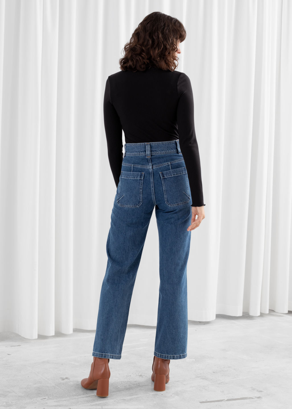 Model back image of Stories straight high rise utility jeans in blue