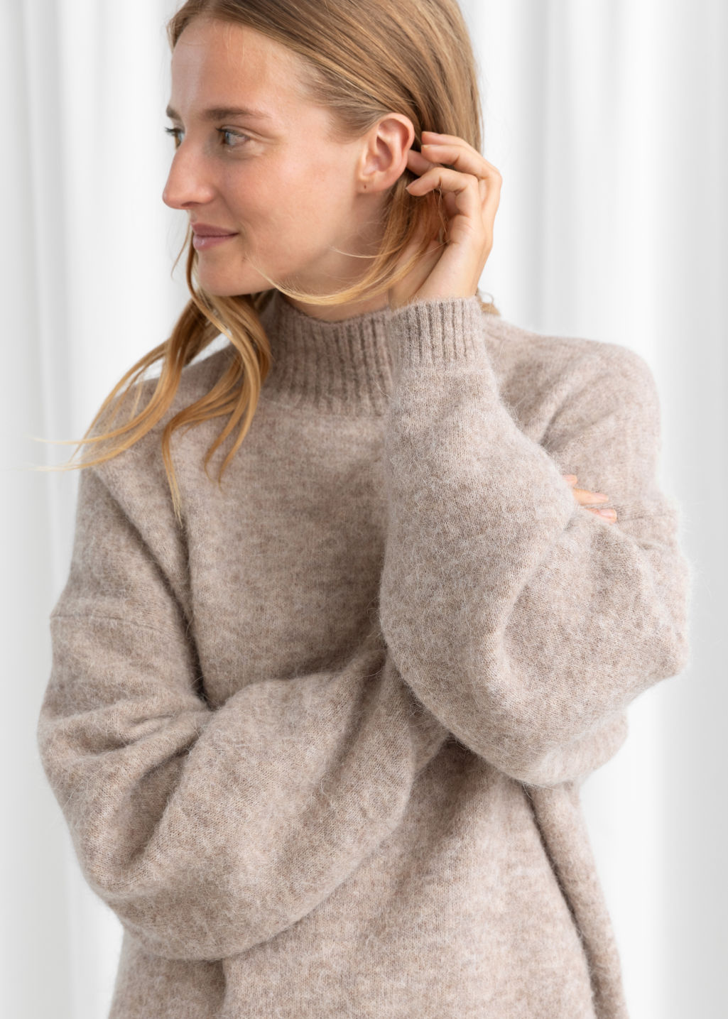 Model front image of Stories oversized fuzzy wool blend sweater in beige