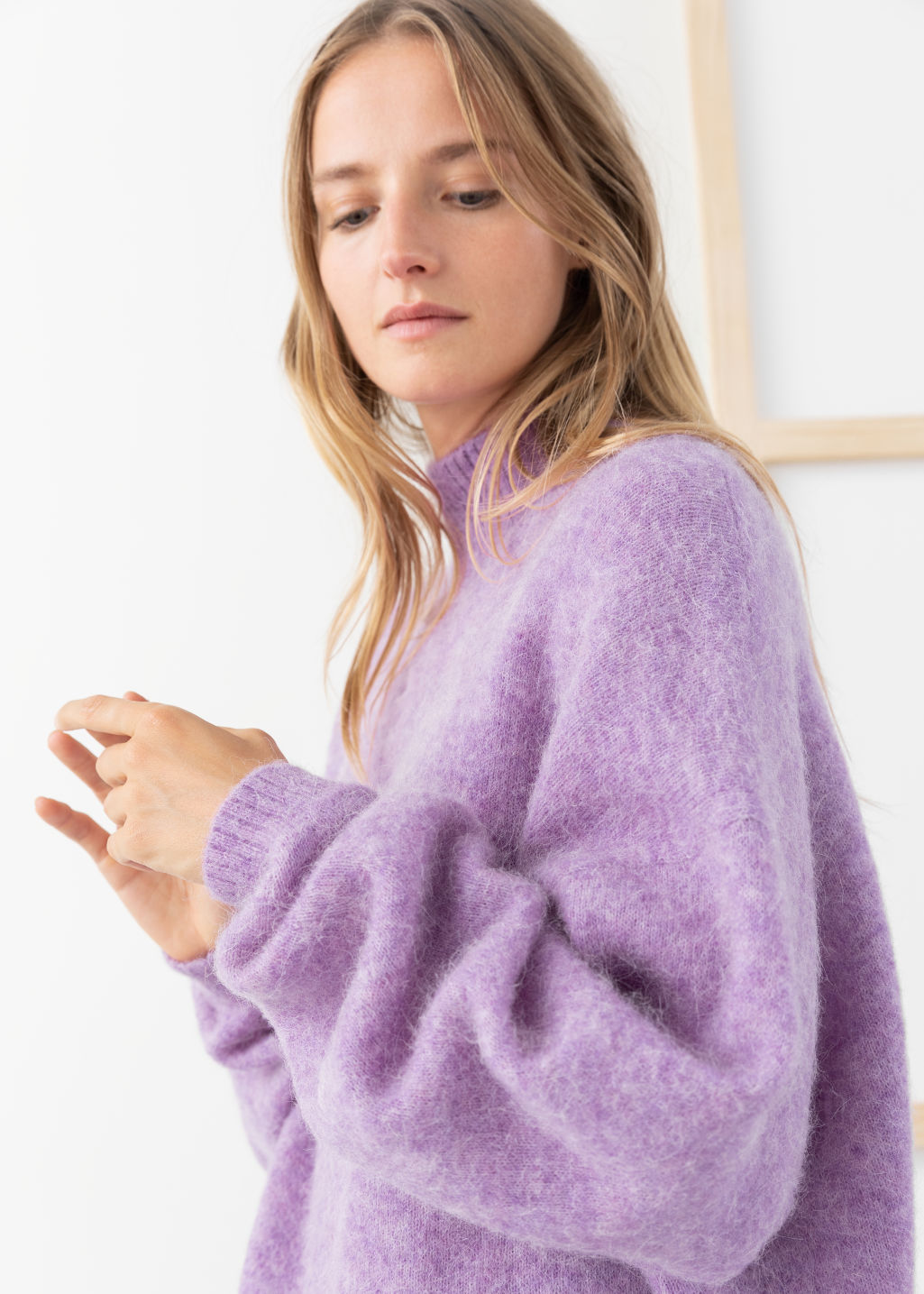 Model side image of Stories oversized fuzzy wool blend sweater in purple