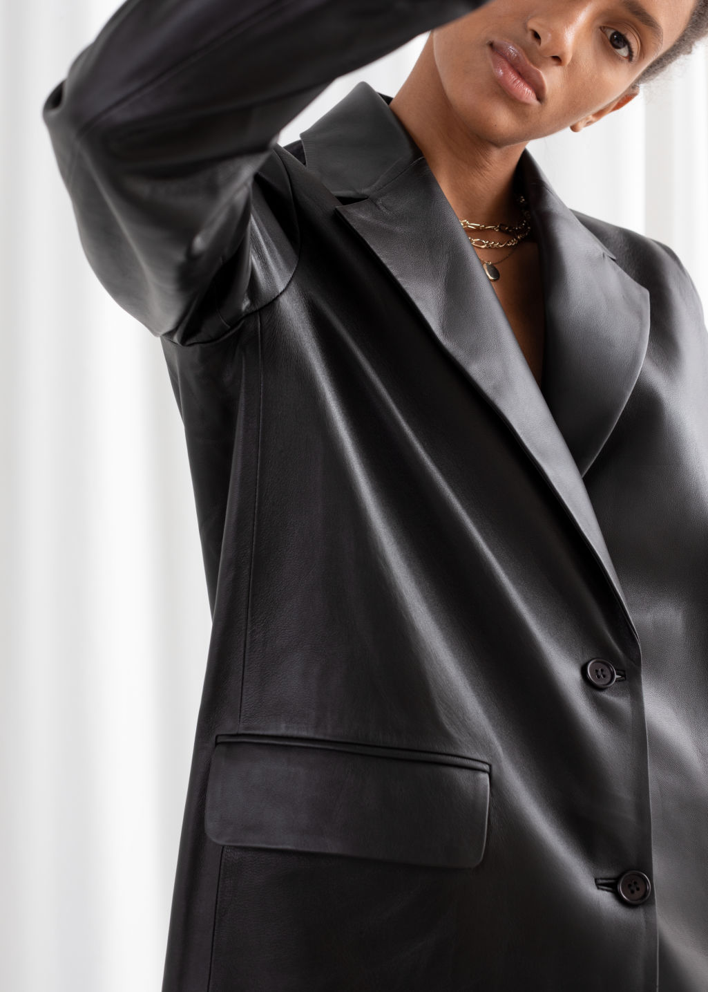 Model back image of Stories oversized leather blazer in black