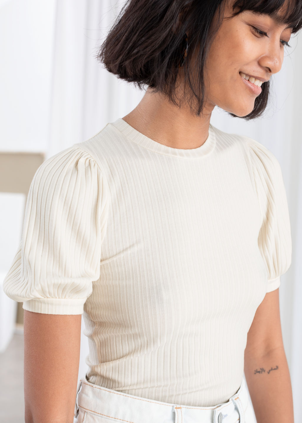 Model back image of Stories high neck puff sleeve top in white