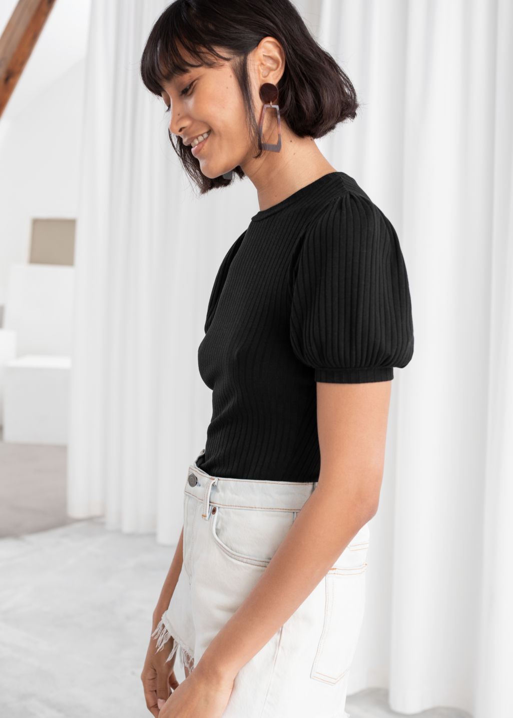 Model front image of Stories high neck puff sleeve top in black