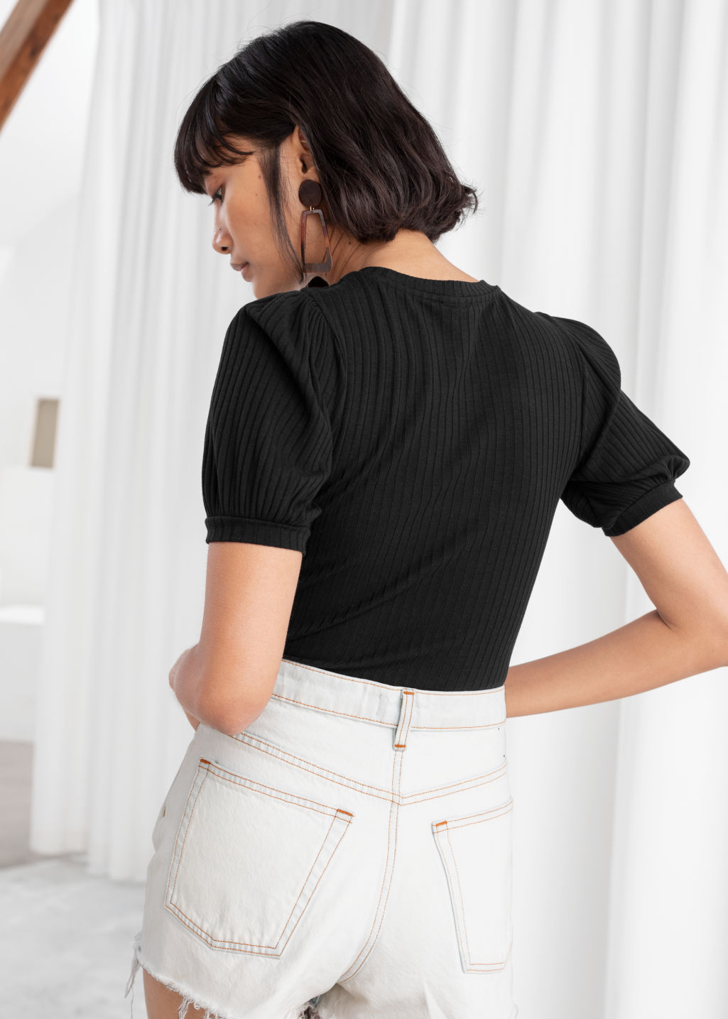 Model back image of Stories high neck puff sleeve top in black
