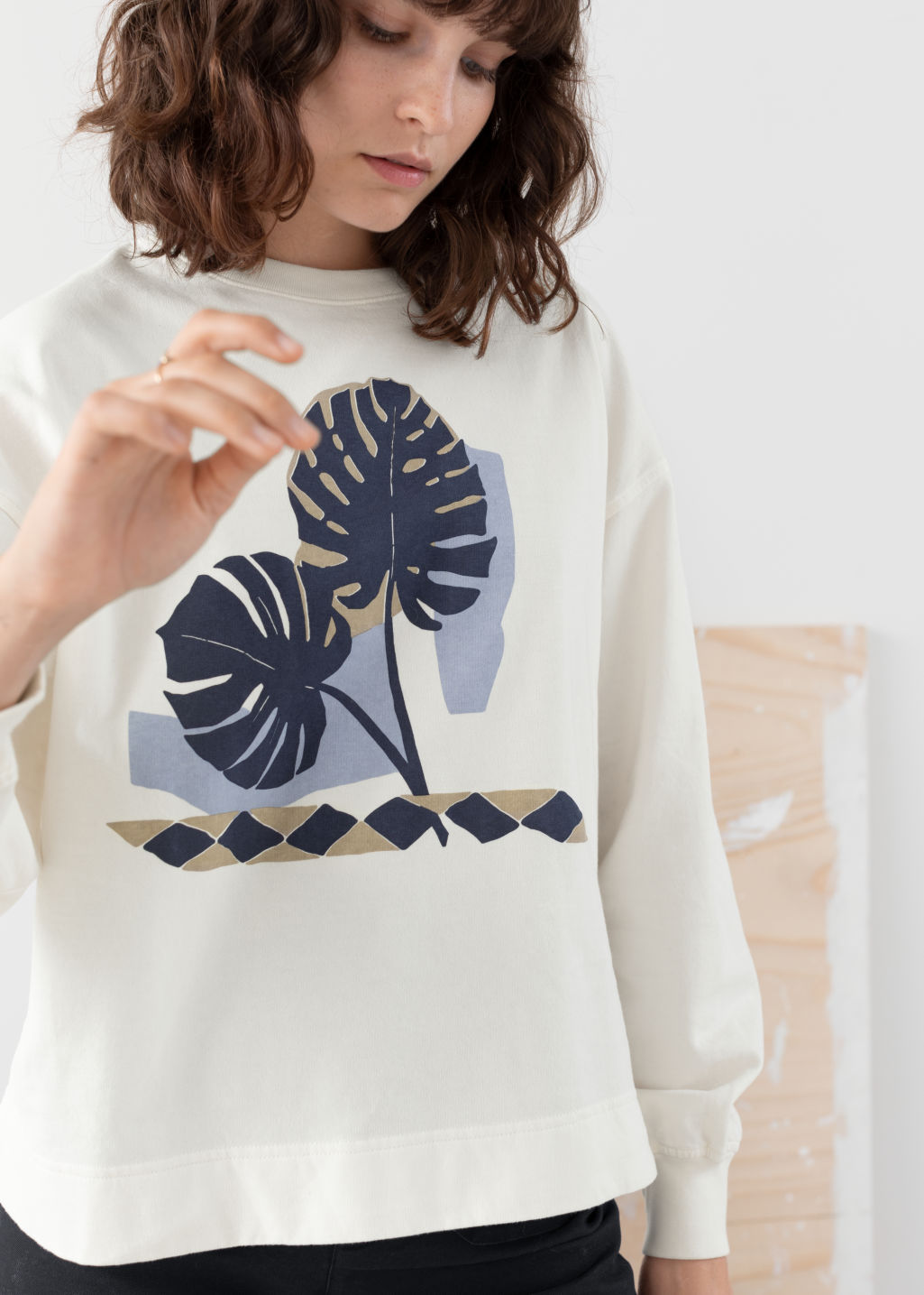 Model front image of Stories cotton graphic print sweater in white