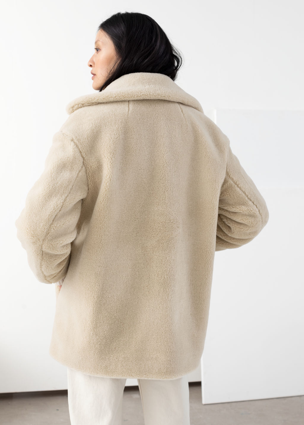 Model back image of Stories faux fur wool blend jacket in beige