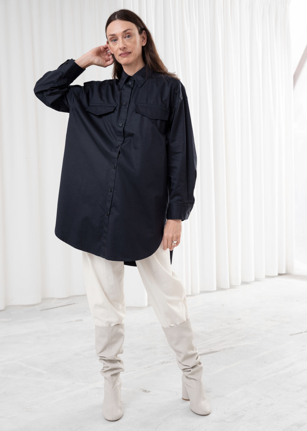 Model front image of Stories oversized utility button down shirt in blue
