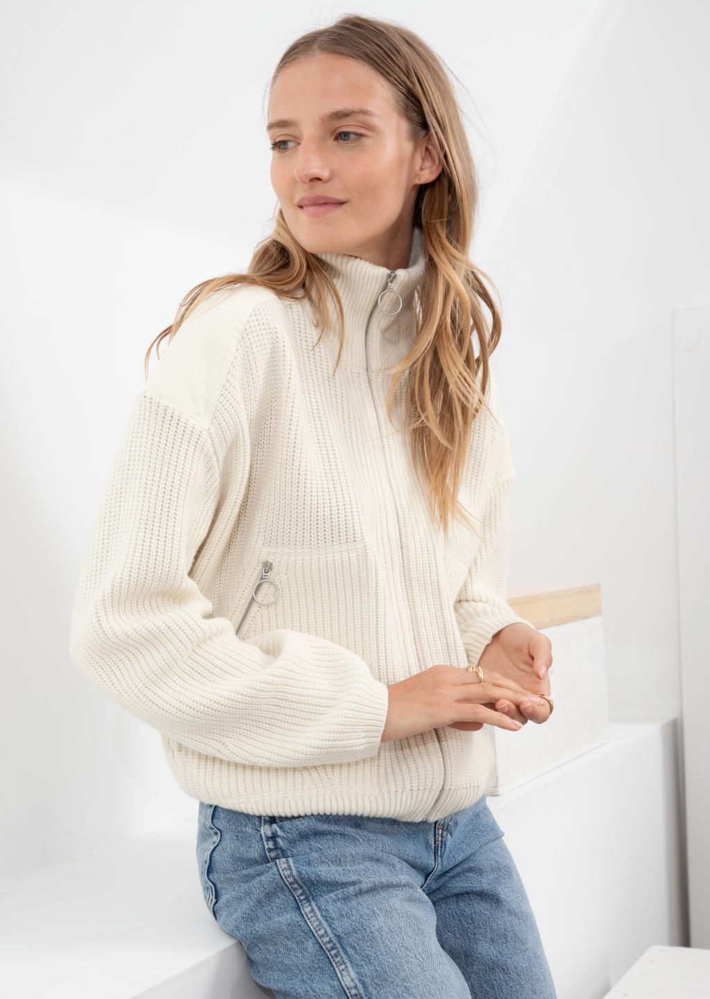 Model front image of Stories wool blend zip turtleneck cardigan in white