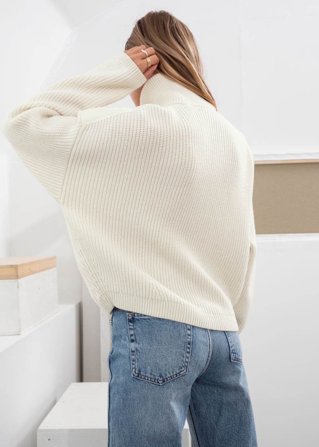 Model back image of Stories wool blend zip turtleneck cardigan in white