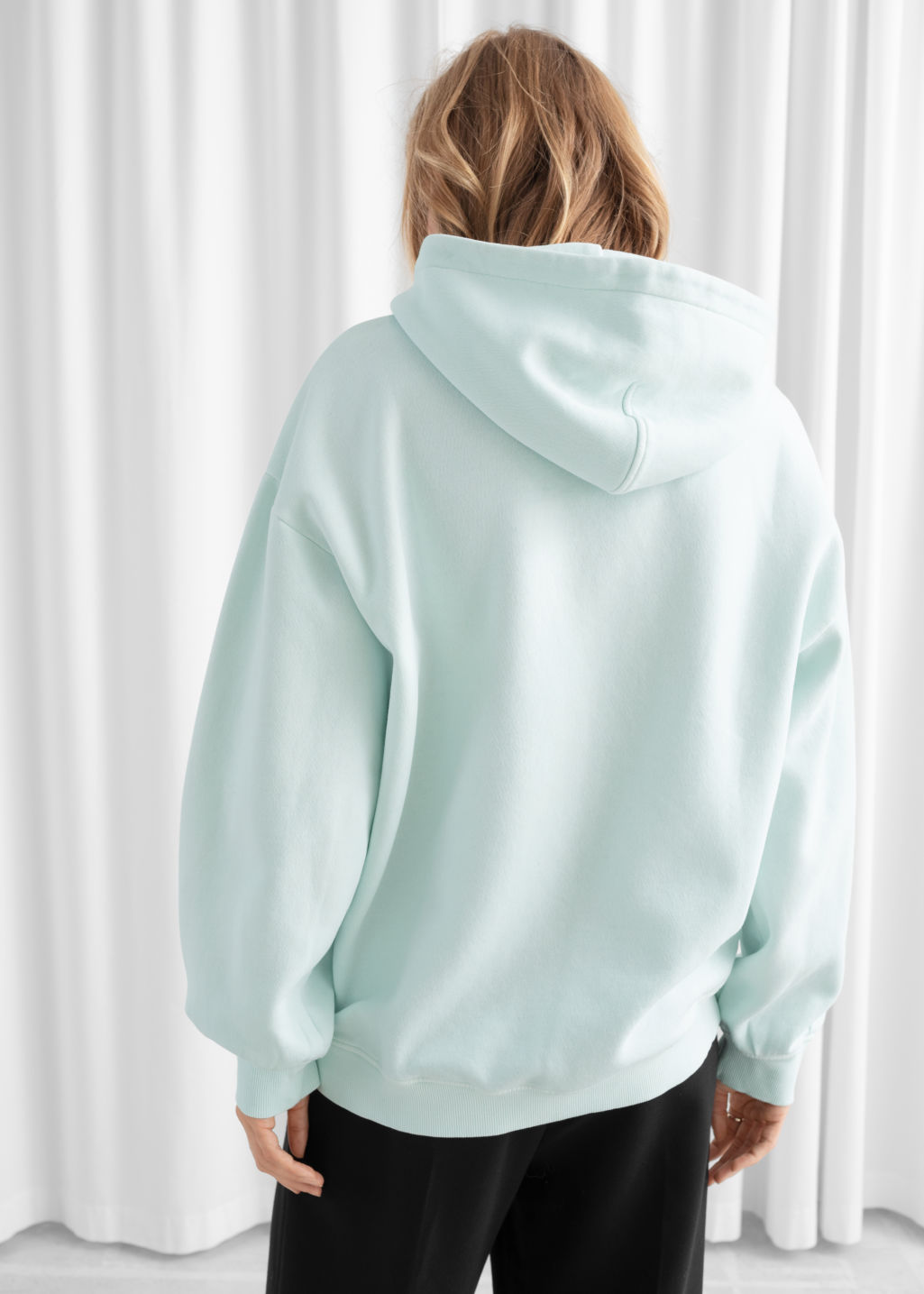 Model back image of Stories oversized hooded sweatshirt in green