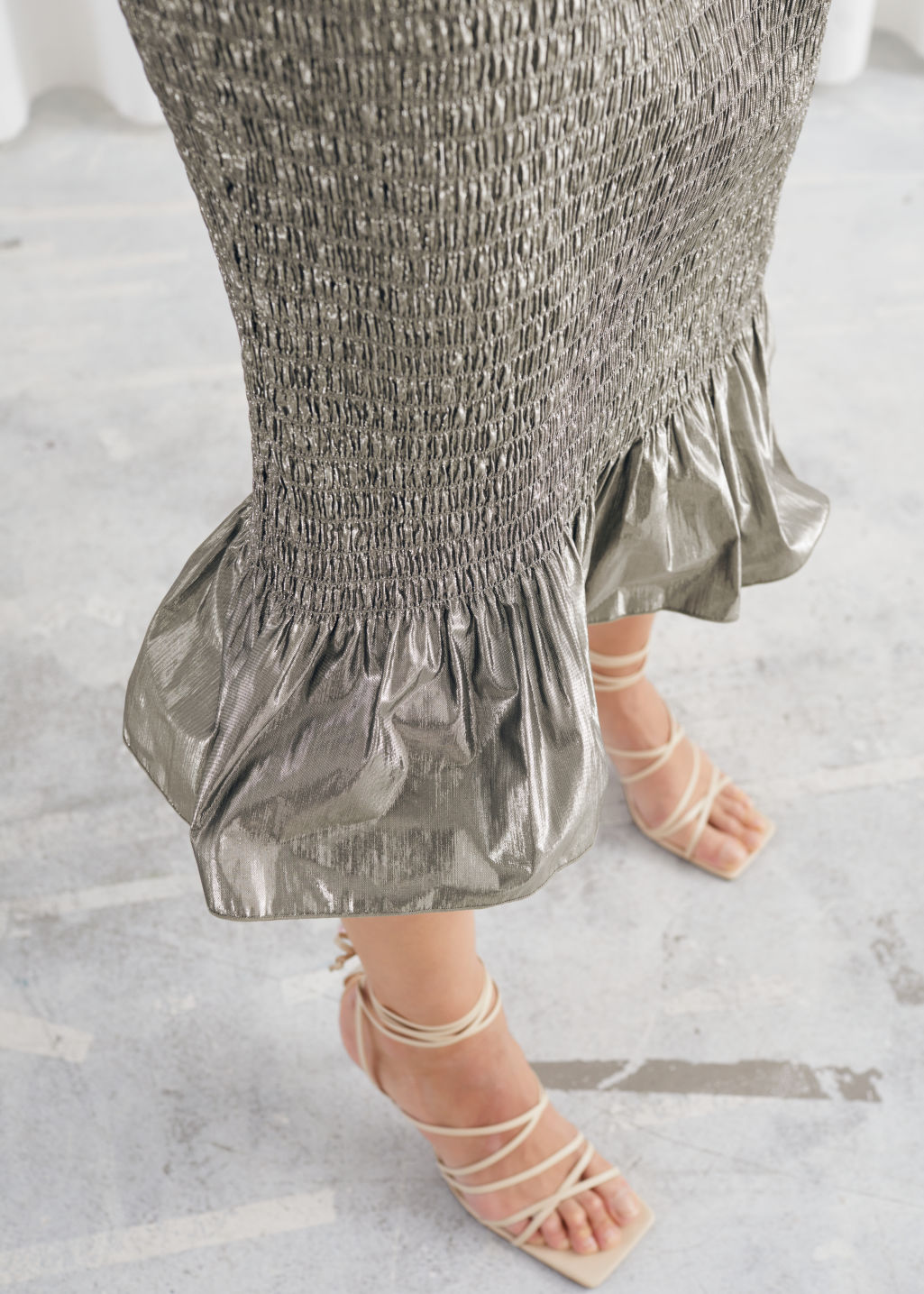 Model side image of Stories smocked metallic midi ruffle skirt in beige