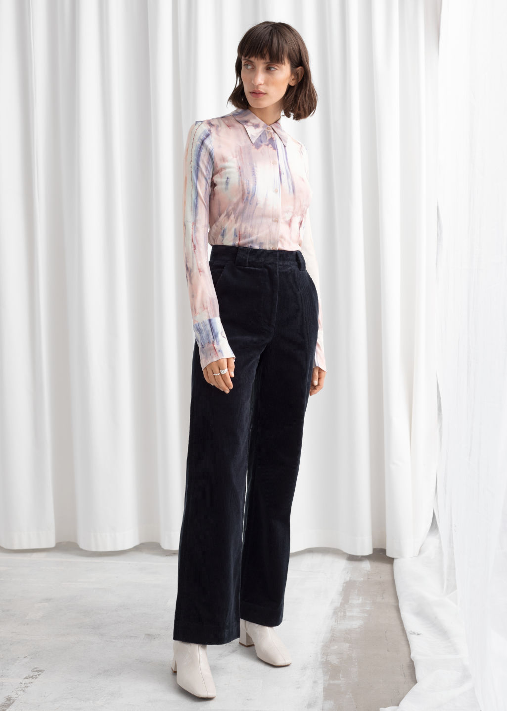 Model front image of Stories corduroy flared trousers in blue