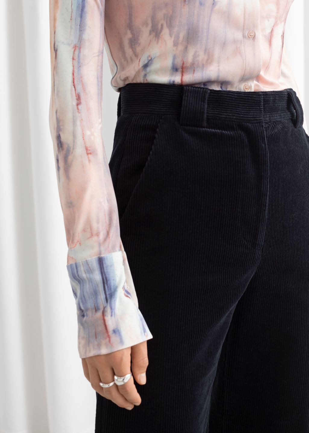 Model side image of Stories corduroy flared trousers in blue