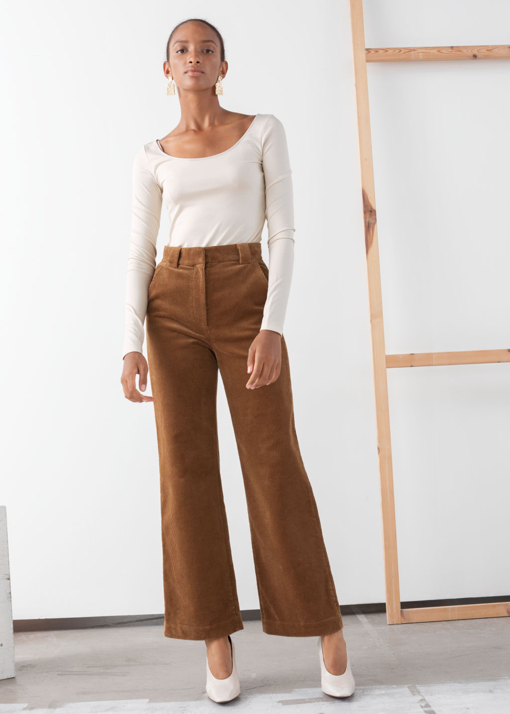 Model front image of Stories corduroy flared trousers in beige